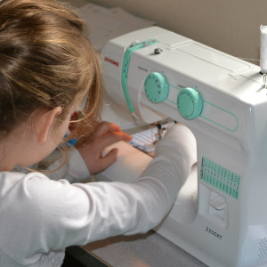 how to teach a child to sew