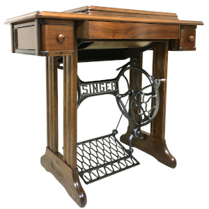 old sewing machine with pedal